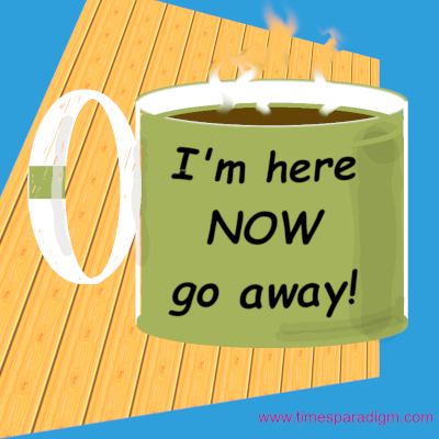 A coffee cup with the words: I am here now