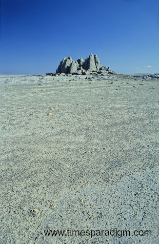 The mysterious rock formation rising from the flat Kalahari Desert